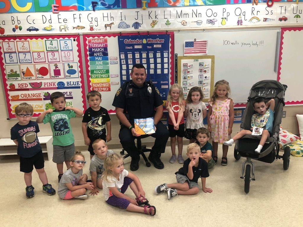 SRO Waddle read a book on 9/11 to Ms. Valentine's Pre-K class.