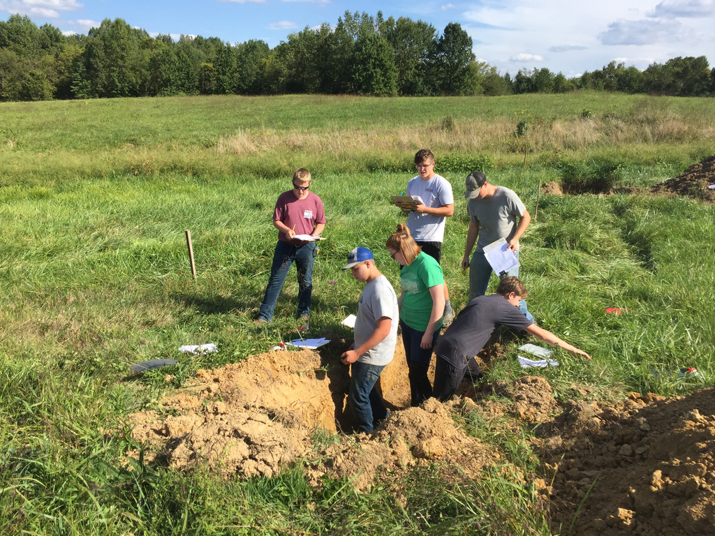 Students practicing soil judging